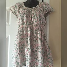 Floral Print Maternity Top In great condition. This floral shirt (pink & green) is super comfortable. Measurements are 13 1/2 inches across the bust, 13 inches across the waist unstretched & 25 inches from top to bottom. 100% cotton. Maternity size M. Two Hearts Maternity Tops Blouses