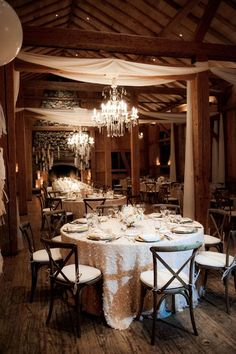 ivory sequin wedding reception linens in cozy rustic cabin http://itgirlweddings.com/winter-wonderland-wedding/
