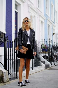 Wear your leather jacket with a mini skirt and sneakers for a casual-cool look. // #StreetStyle