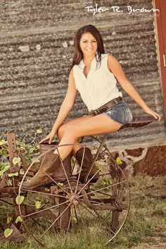 Haily sits on some old tractor equipment at Frisco Square.