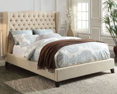 Love this linen wingback upholstered bed with deep tufting and nail head trim! http://farbelowretail.net/shop/faye-linen-platform-bed/