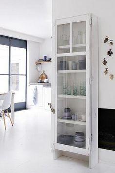 Wonderful tall white skinny shelves.