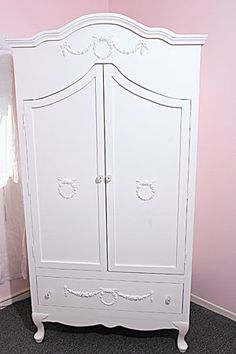 French wreath armoire.