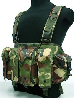 AK Magazine Chest Rig Carry Vest Camo Woodland by AirSoft. $48.99. FEATURES: Made by high density Nylon material. Special force combat version. Quick release buckle for wearing. Fully adjustable in size. Including all pouches and accessory holders shown in photos. 4 rifle magazine pouches can hold up to 2pcs 7.62 type (or 3pcs 5.56 type) banana shape magazine. 2 side utility pouches. 1 built-in button flip chest platform compartment. Waist belt can be added. (not...