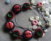 Necklace with vintage buttons blue, green, red