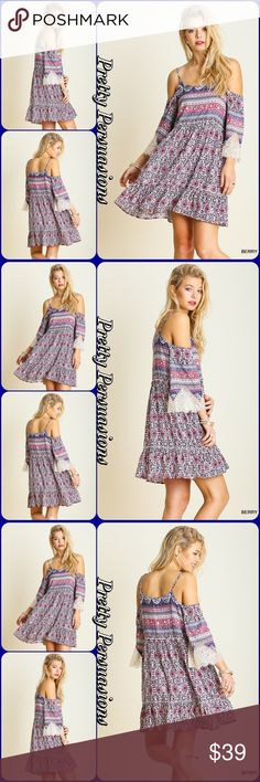 """Floral & Lace Ruffle Hem Bell Sleeve Boho Dress NWT Floral & Lace Open Shoulder Ruffle Hem Bell Sleeve Dress  Available in sizes M, L Measurements taken from a Sm Length: 35"""" Bust: 37"""" Waist: 34"""" Hips: 46""""  Features • lace trim sleeves w/lightly fringe frayed hem • bell sleeves • adjustable spaghetti straps • open/exposed shoulders • ruffle trim bottom hem • vintage boho hippie mixed printed design • soft, breathable material • relaxed fit  Cotton blend  Bundle discounts available No pp or…"""
