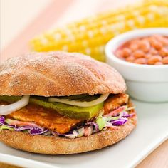 Though vegetarian BBQ may be an oxymoron, once you take a bite of this delicious tofu sandwich topped with coleslaw and dill pickles you won't mind the contradiction. Serve with: Baked beans and corn on the cob. Vegan Bbq Recipes, Vegan Sandwich Recipes, Veggie Recipes, Cooking Recipes, Veggie Food, Diet Recipes, Tofu Burger, Tofu Sandwich, Bbq Tofu