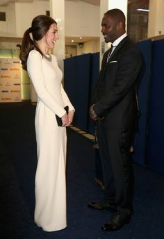 Here's Kate getting giddy in Idris's presence at the UK premiere of Mandela: Long Walk to Freedom in December 2013.