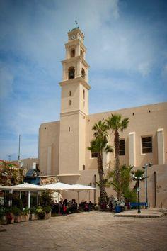 Kikar Kedumim street (Jaffa) and the bell tower of St. Peter's Church. Jaffa, ISRAEL