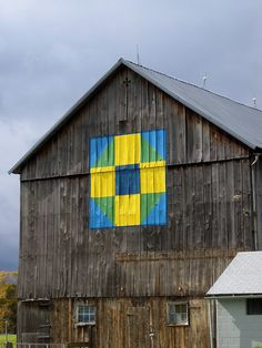 I live how this barn quilt is painted onto the barn ..