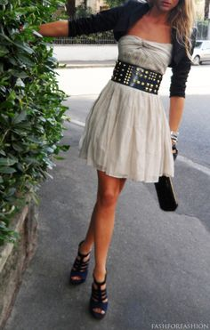 this is the PERFECT mix of girly and edgy! Cute flowy dress amd shrunken cardigan with thick black studded belt and strappy black heels. Completely in love<3