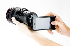 """This Photojojo lens mount($240) turns your iPhone into a silly SLR lenses. It is ridiculous strapping a zoom or L-lens to an iPhone 4, but at least you'll have the large (for a DSLR) 3.5-inch Retina Display touchscreen  """"This case-adapter combo lets you mount your Canon EOS or Nikon SLR lenses to your iPhone 4 giving your phone powerful depth of field and manual focus. """""""