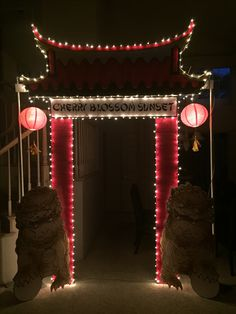 Magalie Sarnataro's props. Chinese gate with lights 9x8 : foam board cutout, paint, lanterns with Fu lions Entrance Asian themed party