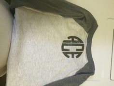 Square letters in back of shirt