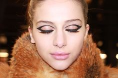 Extreme cat eye liner is looking hot for fall. Ralph Rucci Fall / Winter 2013 | more on jenesequa.com