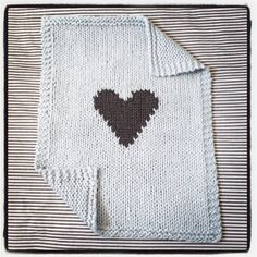 Beautiful knitted blanket, shown in pale blue with grey heart. Made of thick Organic cotton yarn, perfect to bundle those summer babies! Perfect size to cover infant in car seat and stroller or use as bassinet bedding.  100% certified organic cotton  This blanket is size: 18 x 22  All items are pre washed and ready to be gifted.  As with any handmade item, there may be minor variations in color and size.  Shipping: Ships worldwide from Canada. Items are shipped 1-2 weeks after ordering. If…
