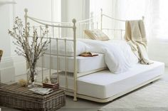 #LauraAshleySS14 stunning victorian style Daybed.This is my favorite from #LauraAshley website because.the ivory colour on this Day Bed makes it perfect for any room. contemporary design that brings calmness into any style room. This inspires me to create my own personal space within my room then i can just lay and listen to music. This reminds me back to when i went to America, the old Vintage/Shabby Chic breach front houses by the sea. Always inspires me to create my own house similar to…