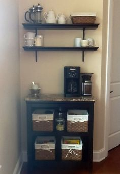 Our new coffee and tea center/ station. Target bookcase and shelves with a granite remnant. Makes me happy!