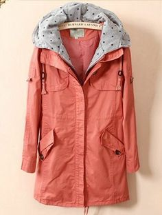 Light pink/peach colored military-esque jacket with polkadot lining