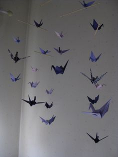 Who says mobiles are for infants? This sophisticated violet-hued variety, made of hand-folded origami cranes, adds instant interest to the room. Origami Cranes, Paper Cranes, Crane Mobile, Mobile Art, Origami Mobile, Big Girl Rooms, Infants, Mobiles, Wind Chimes