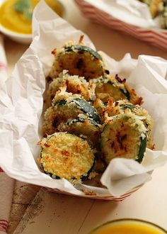 Seriously nosh-worthy, this recipe for Crispy Baked Coconut Zucchini gives zukes a tropical twist. That irresistible Mango-Jalapeno Dipping Sauce seals the deal. Dairy-free recipe via Vegetarian Recipes, Cooking Recipes, Healthy Recipes, Snacks Recipes, Healthy Foods, Zucchini Bread, Healthy Zucchini, Coconut Recipes, Side Dish Recipes