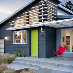 Paint on Eaves/Fascia is Benjamin Moore Gunmetal, Siding is Graphite, Stucco is Timberwolf, door is Tequila Lime