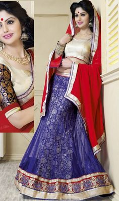 Be your exclusive trend diva with this bluish purple color net and jacquard choli skirt. This attire is nicely made with lace work. Upon request we can make round front/back neck and short 6 inches sleeves regular choli blouse also. #netlehengacholi #lehengacholie #cholieskirt