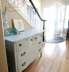 Don't like the hardware but I come from a long line of painters of wood furniture. Totally into it.