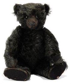 J.K. FARNELL BLACK TEDDY BEAR, jointed, long mohair, black boot button eyes, black stitching, black felt pads, card lining to feet pad and inoperative squeaker, circa 1912 --14in.