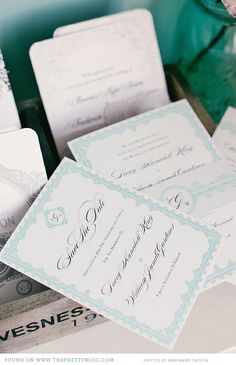 Turquoise and white lace wedding stationery.