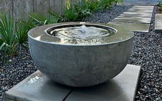 Concept photo showing fountain installation on pavers rather than on gravel.