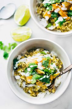 Roasted Tomatillo Chicken and Rice Bowls - shredded chicken with homemade Roasted Tomatillo sauce on rice with cilantro, sour cream, and tortilla strips.