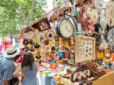 On Sundays, locals head to the historic neighborhood of La Latina for one specific event: El Rastro. It's the biggest open-air flea market in Madrid and one of the largest in Spain, with thousands of stalls crowding the streets. Here, you'll find myriad accessories, home goods, and locally-made items, and there are food vendors serving tapas and beer.