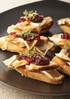 Grilled Chicken & Brie Crostini with a cranberry relish garnish & a bit of fresh thyme