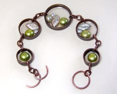 Bracelet prototype made with recycled copper pipe, UV resin, freshwater pearls and copper wire. Up-cycled Jewelry