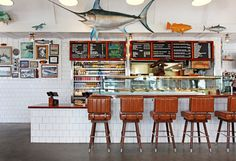 By DANIELLE PERGAMENT At Bear Flag Fish Company, they don't take reservations, there's no table service and you'll probably have to stand in line for a while to order your food. Published: December 2015 at from NYT Travel Article. Restaurant Themes, Restaurant Concept, Seafood Restaurant, Restaurant Design, Coffee Shop Interior Design, Cafe Interior, Black And White Picture Wall, Bar Lounge, Newport Beach