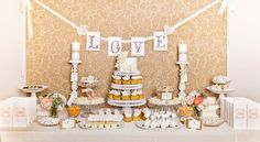 dessert table from Sandra Downie #dessert #table #party #wedding #cupcakes #brown #orange #yellow #white #candy #cake #pops #bars #love