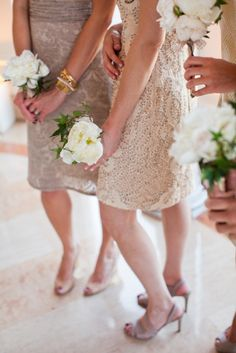 a fusion of cream colored bridesmaids dresses and beautifully wild peony bouquets  Photography by firstcomeslovephoto.com, Event Design by shannonleahy.com, Floral Design by michaeldaigian.com