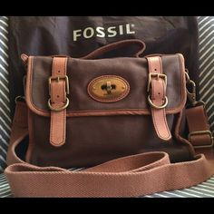 Fossil Vintage Re-Issue Cross-body Bag Fossil Vintage Re-Issue cross-body bag. Canvas bag in excellent condition. Minimal blue tinge from jeans on the edge of the leather trim surrounding the brass Fossil logo on the back (can be seen on the 2nd photo). Fossil Bags Crossbody Bags
