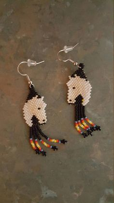 Beaded Horse Earrings, hand crafted by Navajo artist Agnes Davis. These earrings are authentic Native American made. Seed Bead Jewelry, Seed Bead Earrings, Etsy Earrings, Beaded Jewelry, Beaded Earrings Patterns, Beading Patterns, Navajo, Brick Stitch Earrings, Beadwork Designs