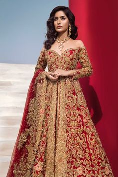 Colour: Red & Gold Includes: Gown, Lehnga, Dupatta Gown: Net, Tissue Lehnga: Tissue Dupatta: Net