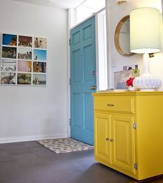 love the aqua door and yellow dresser not to mention the lamp mirror and pictures
