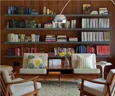 Shelving Simplified: 9 Ideas for Living Rooms By Tiffany Burgess- Create Wall Art Rows of sleek, floating shelves create a focal point in this mid-century modern library.