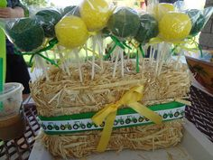 John Deere cake pops in a mini hay bale. Idea for Levi's tractor themed birthday party this weekend