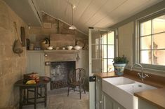 Millers Point Gallery Clive Lucas Sydney how to do a functional old style elegant kitchen. Note floor, ceiling lining wooden benchs, colour of cabinets and windows.