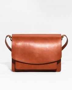 Quality vegatable tanned leather adds longlived authenticity to this structured … Quality vegatable tanned leather adds longlived authenticity to this structured shoulder bag detailed with saddle stitching for a clean and durable finish. Black Leather Bags, Tan Leather Handbags, Small Leather Bag, Leather Totes, Leather Purses, Leather Crossbody, Orange Bag, Best Bags, Stitching Leather