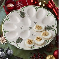 Boasting classical illustrations of the Spode Christmas tree and other seasonal foliage, this deviled eggs dish supplies a touch of tradition to festive family dinners. Champagne Christmas Tree, Spode Christmas Tree, Christmas Dishes, Vintage Christmas, Christmas Ornaments, Deviled Egg Platter, Deviled Eggs, Christmas Tree Collection, Christmas Dinnerware