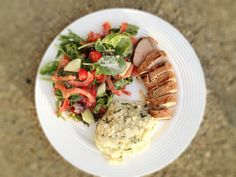 4 ounces grilled pork tenderloin (160 for pork alone since pork is 40 calories per ounce + 30 for marinade = 190) + 1 cup creamy basil millet (235) +1 1/2 cups mixed salad (20) + 1 tablespoon Ken's Lite Options Caesar dressing (40) = 485