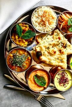 Here you'll find vegetarian fare, meaty tandoori, whimsical pizzas, massive dosas, and much, much more