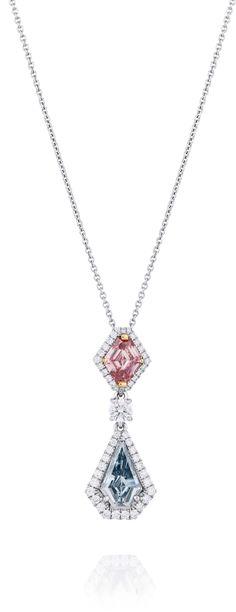 De Beers 1888 Master Diamonds Aura pendant, set with a shield-cut Fancy Intense pink diamond, round brilliant diamonds and a shield-cut Fancy Intense blue diamond.
